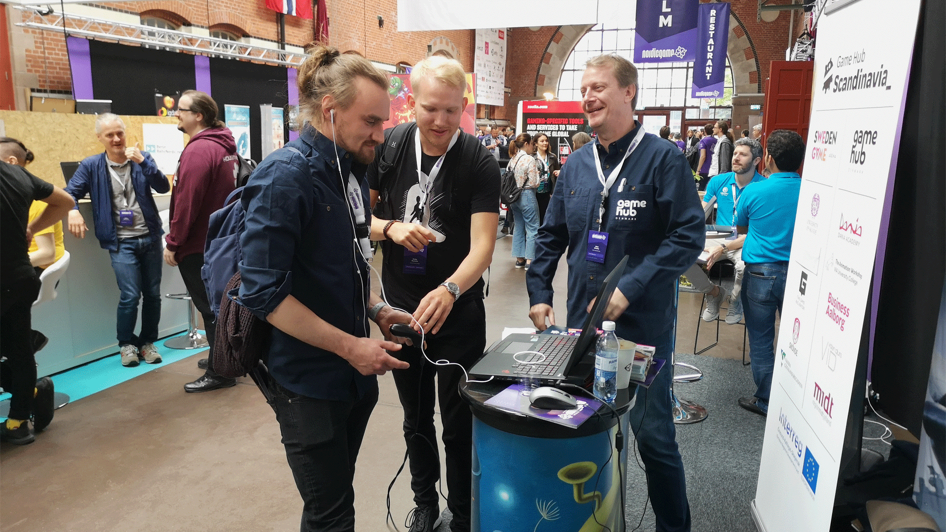 Visitor playing game at Game Hub Denmark booth
